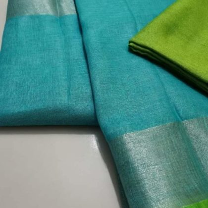 Sky blue plain linen saree with green blouse