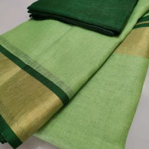Pista green plain linen saree with dark green blouse